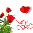 Red roses with hearts and greetings for valentines day - Stockfoto