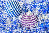 Pink and blue christmas balls with decoration — Stock Photo