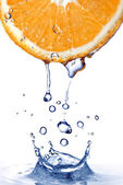 Resh water drops on orange with water splash — Stock Photo