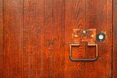 Handle on the wooden door — Stock Photo