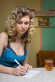 Young woman writing a notice — Stock Photo