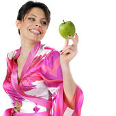 Young beautiful happy woman holding green apple on white — Stock Photo