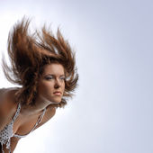 Young woman with hair in motion — Stock Photo