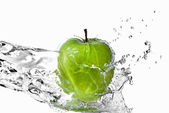 Fresh water splash on green apple isolated on white — Stock Photo