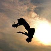 Silhouette of jumping man against sky and clouds — Stock Photo