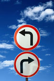 Two opposite road signs against blue sky and clouds — Fotografia Stock