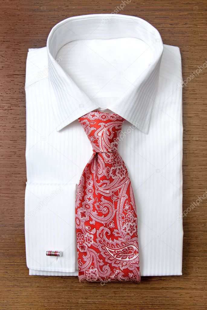 White shirt with red tie on wooden shelf — Stock Photo #3384437