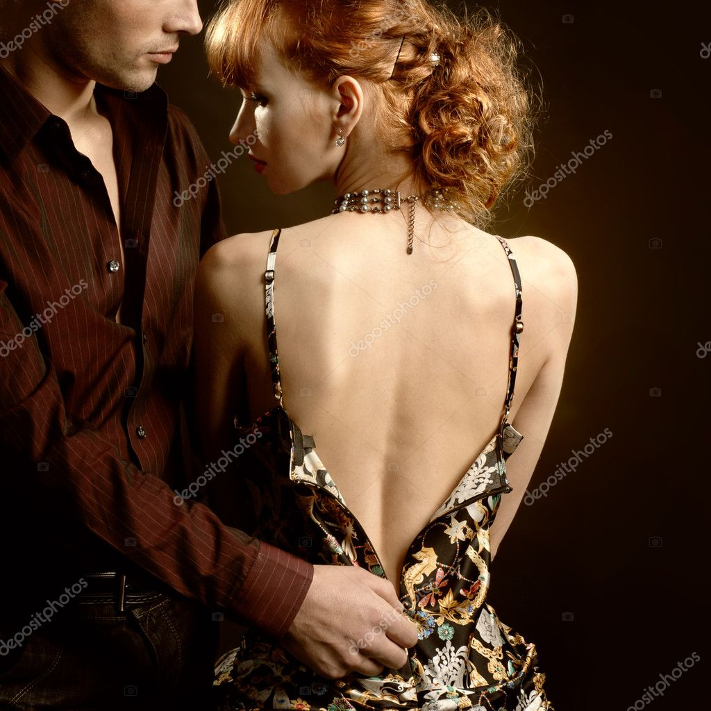 Man undresses woman — Stock Photo #3385307
