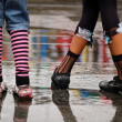 Stock Photo: Emo shoes standing under the rain