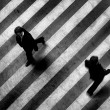 Busy crosswalk scene on the stripped floor - Стоковая фотография