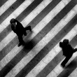 Busy crosswalk scene on the stripped floor - Stok fotoğraf