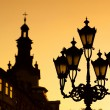 Silhouettes of city lantern on the sunset - Stock Photo