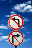 Two opposite road signs against blue sky and clouds — 图库照片