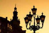 Silhouettes of city lantern on the sunset — Stock Photo