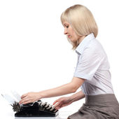 Business woman with vintage typing machine on white — Stock Photo