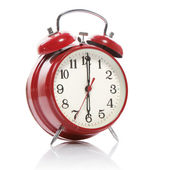 Red old style alarm clock isolated on white — Stockfoto