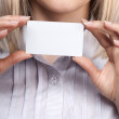Woman hand holding empty visiting card — Stock Photo