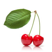 Red cherry with leaf isolated on white — ストック写真