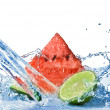 Fresh lime and watermelon with water splash isolated on white — Stock Photo