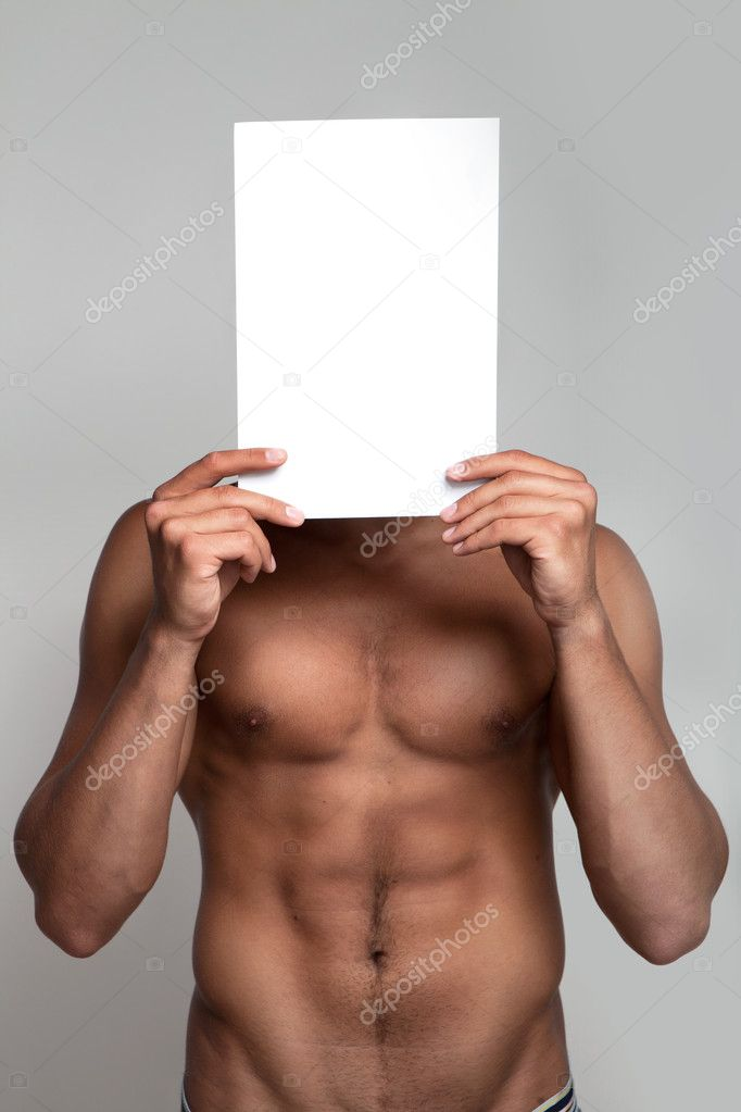 Muscular naked man holding white empty paper  Stock Photo #3700121