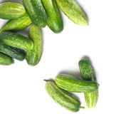 Green cucumbers isolated on white — Stock Photo
