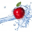 Red apple with leaf and water splash isolated on white — Stock Photo