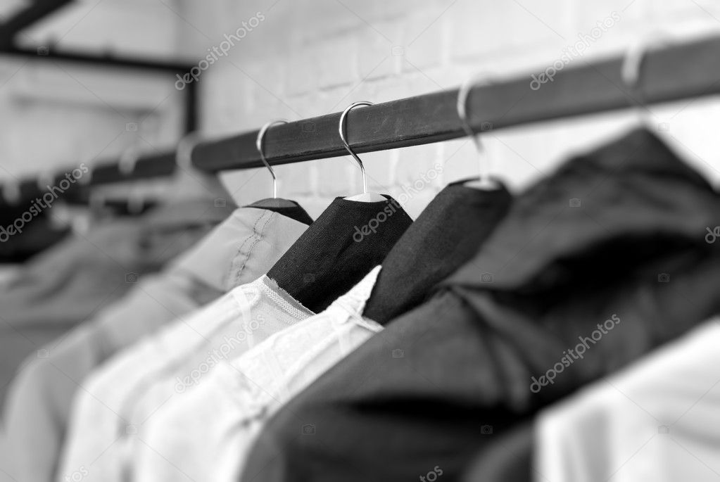 Clothes on racks in store — Stock Photo #3857156