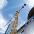 Modern building under construction against blue sky — Stock Photo #3902386