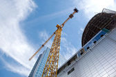 Modern building under construction against blue sky — Stock Photo