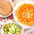 Borsch, black bread and sliced cucumber - Stock Photo