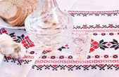 Vodka in decanter, bread and garlic — Stock Photo
