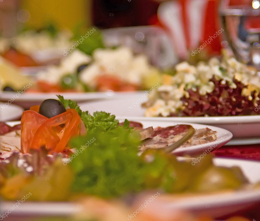 Banquet in the restaurant. Focused on one dish (shallow DOF)  Stock Photo #2714226