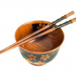 Japanese tableware. Chopsticks and a bowl — Stock Photo #2995581