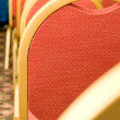 Meeting. Closeup of red Chair back — Stock Photo
