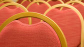 Closeup of red Chair in the conference hall — Stock Photo