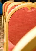 Spotkanie. zbliżenie z tyłu czerwone krzesło — Zdjęcie stockowe