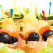 Close-up of canape with olives, cheese and mushr - Stock Photo