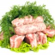 Pork meat, Sausages and dill on green salad - Stock Photo