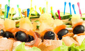 Close-up of canape with olives, cheese and mushr — Stock Photo