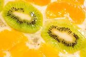 Fruit background. Kiwi and mandarin — Stock Photo