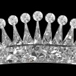 Side view of gemstone crown over black - Stockfoto
