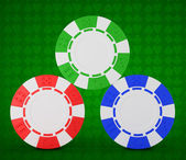 Roulette chips over green textured white — Stock Photo