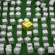 Golden die among common ones - Stockfoto