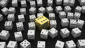 Golden die among common ones over black — Stock Photo