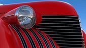 Headlight and engine jacket of red retro car — Stock Photo