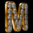 Golden M letter incrusted with diamonds — 图库照片