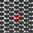 One Red heart among black — Stock Photo
