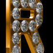 Golden R letter incrusted with diamonds — Stock Photo