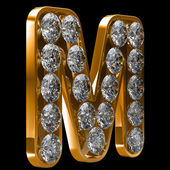Golden M letter incrusted with diamonds — Stock Photo