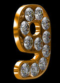 Golden 9 numeral incrusted with diamonds — Stock Photo